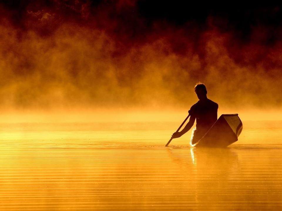 lonely-man-in-a-boat-wallpaper_32221.jpg