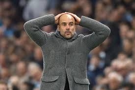 pep guardiola manchester city liga champion.jpg