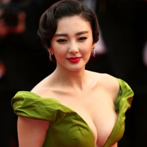 Chinese actress Zhang Yuqi with plunging neckline gown attended Cannes Film Fest