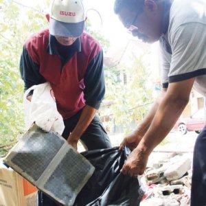 Al-Quran Ditemui Di Tempat Pembuangan Sampah Haram