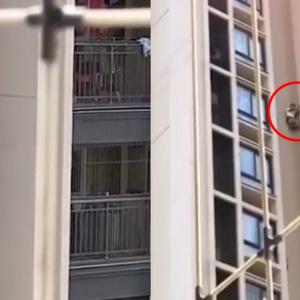 'Melekat' Macam Spiderman, Lelaki Bergayut Telefon Di Tingkat 8