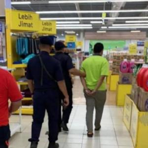 Perakam punggung wanita dalam pasar raya ditahan